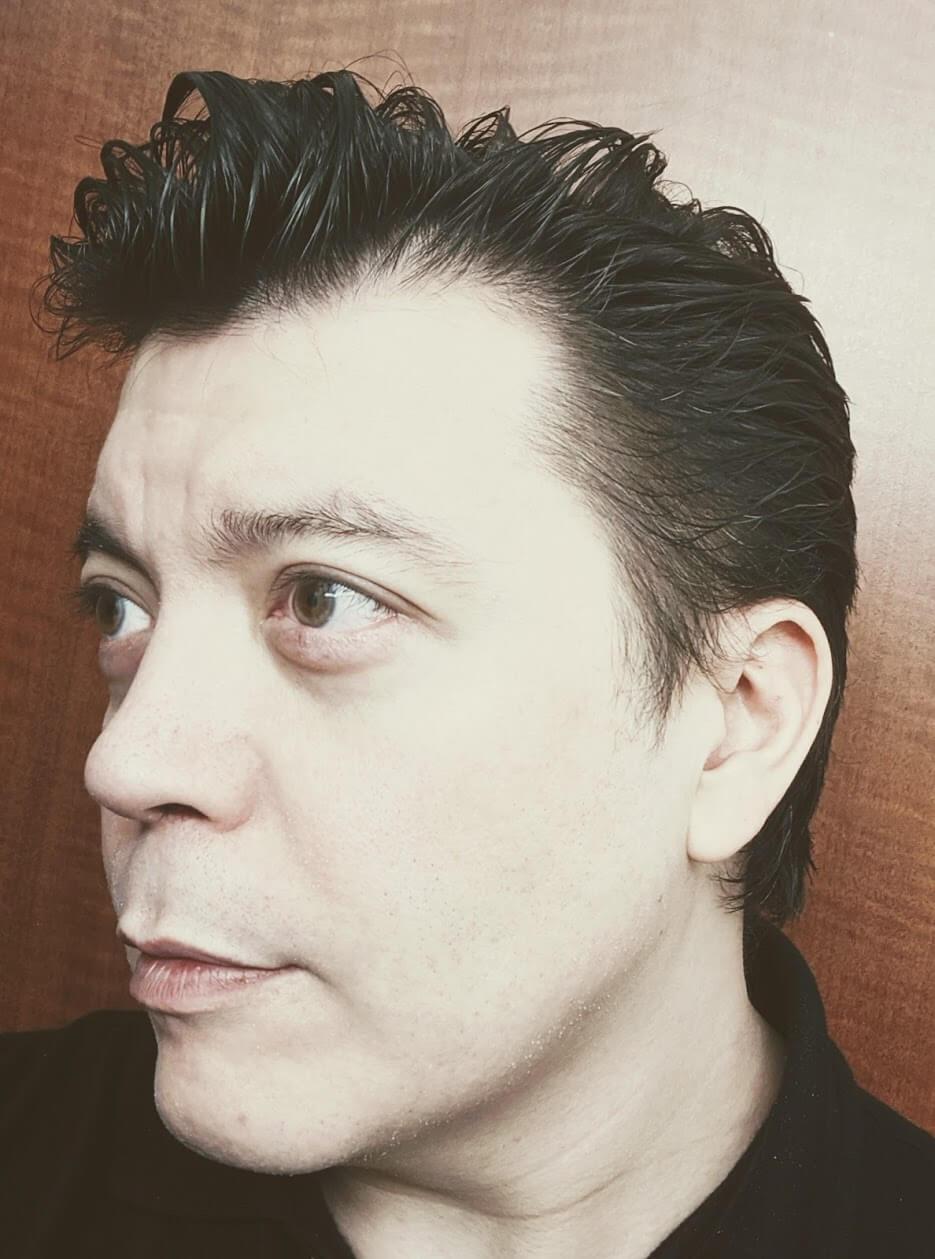 Left side hair style using Paul Mitchell Tea Tree vegan hair Gel